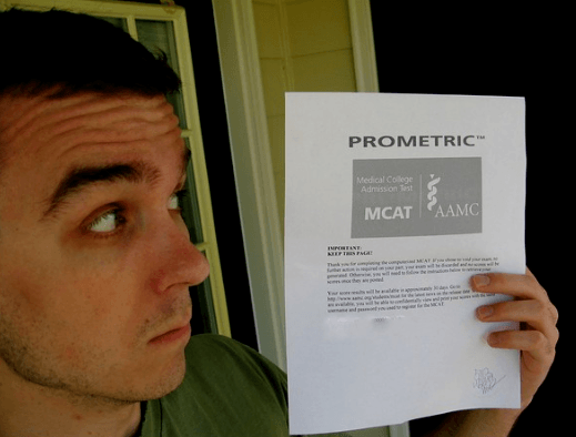 A candidate holding the MCAT paper