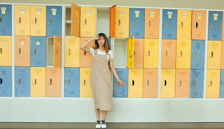 Girl in front of the lockers