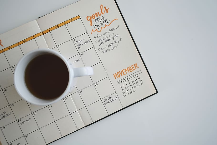 agenda and a cup of coffee