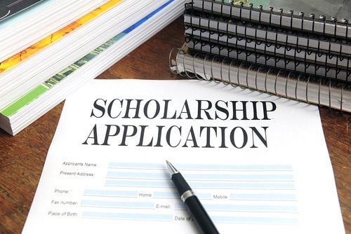 scholarship application and pen