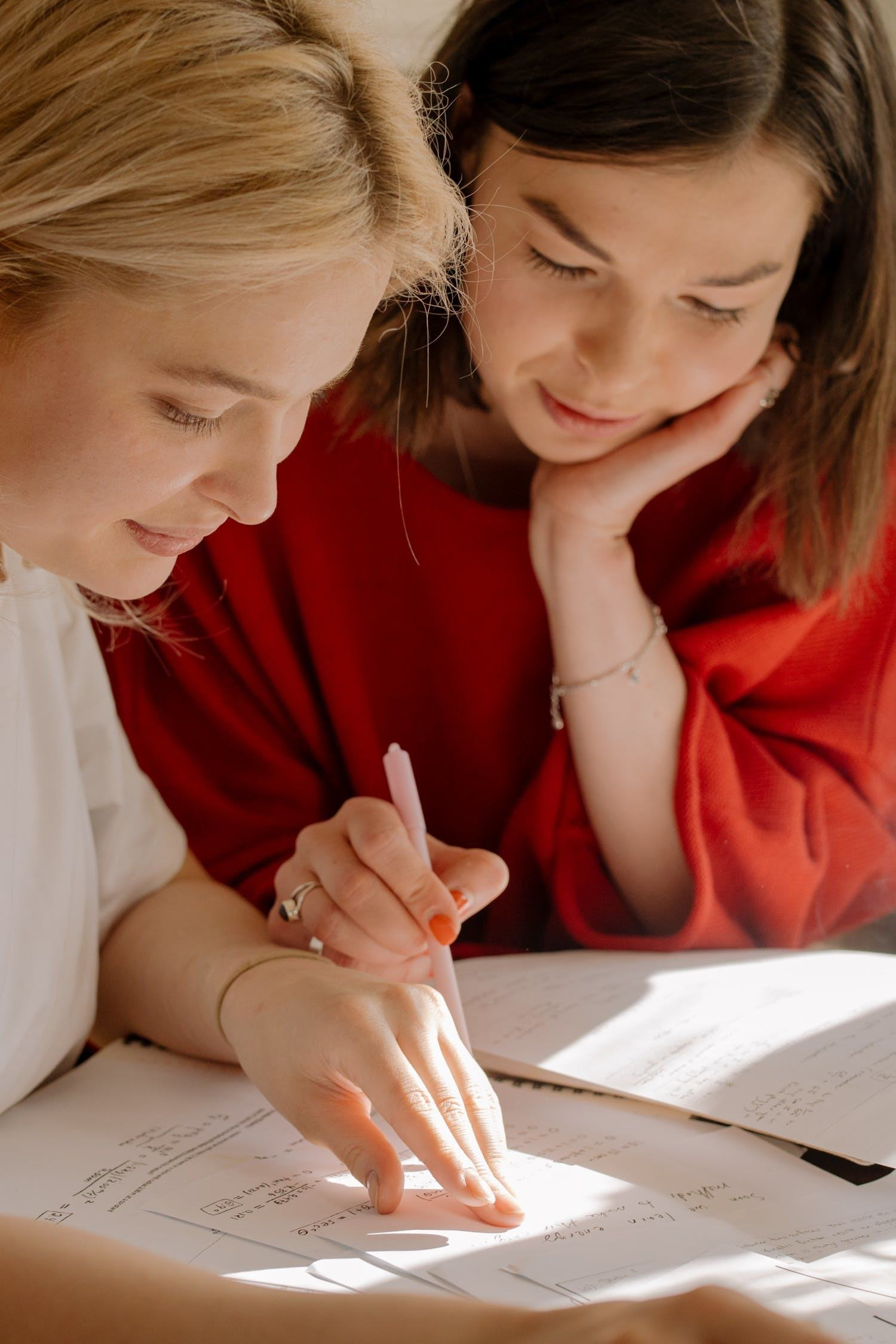 two girls reading and writing