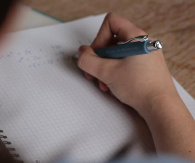 girl holding a pen