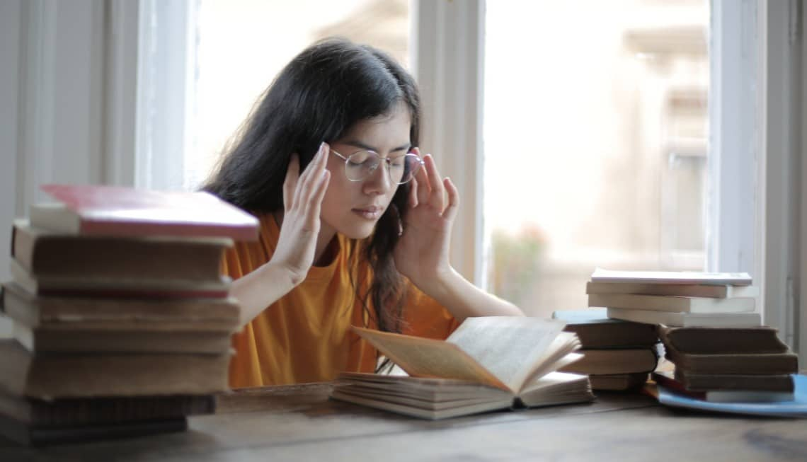 girl reading a lot of books