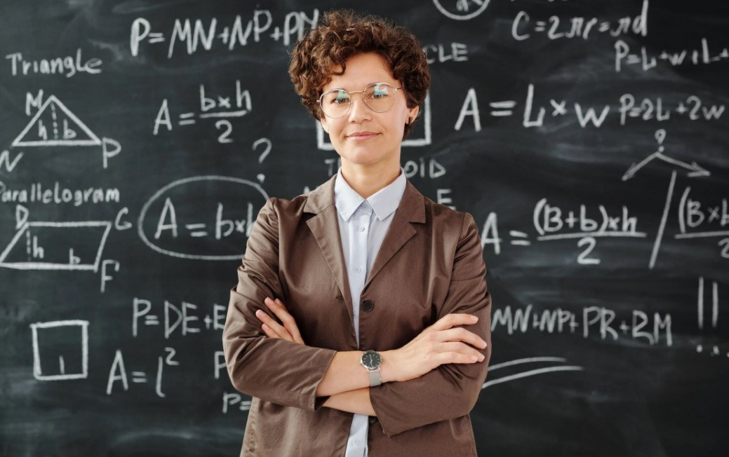 teacher in front of the board
